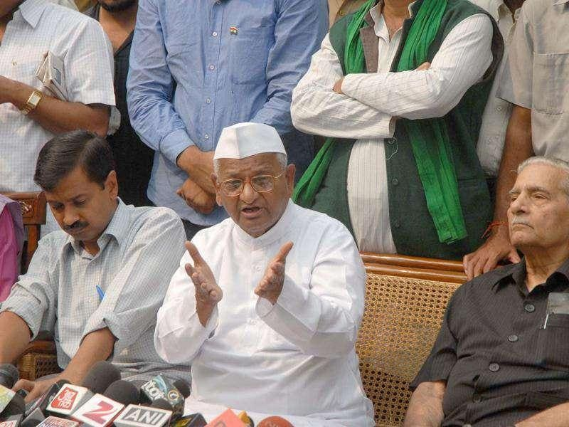Anti-graft crusader Anna Hazare with his team members addressing a press conference at Rajghat in New Delhi.
