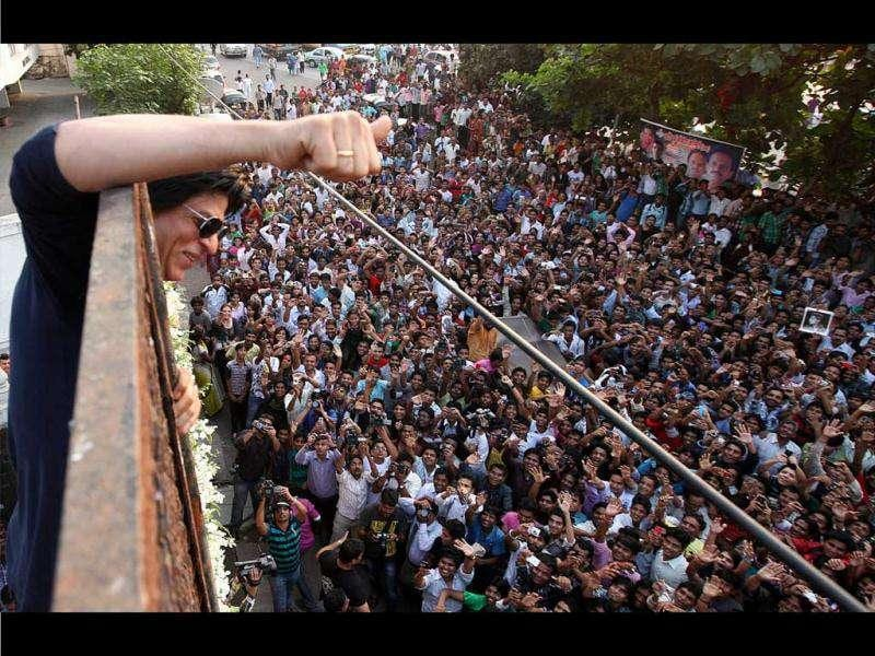Shah Rukh gives a thumbs up to his fans.