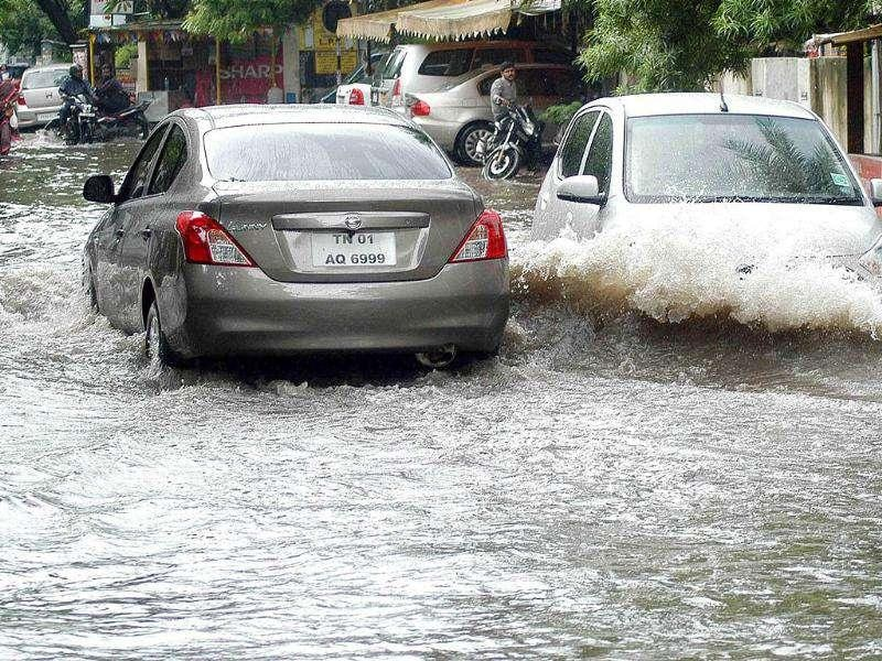 Vehicles passing through a flooded road due to incessant rains in Chennai.
