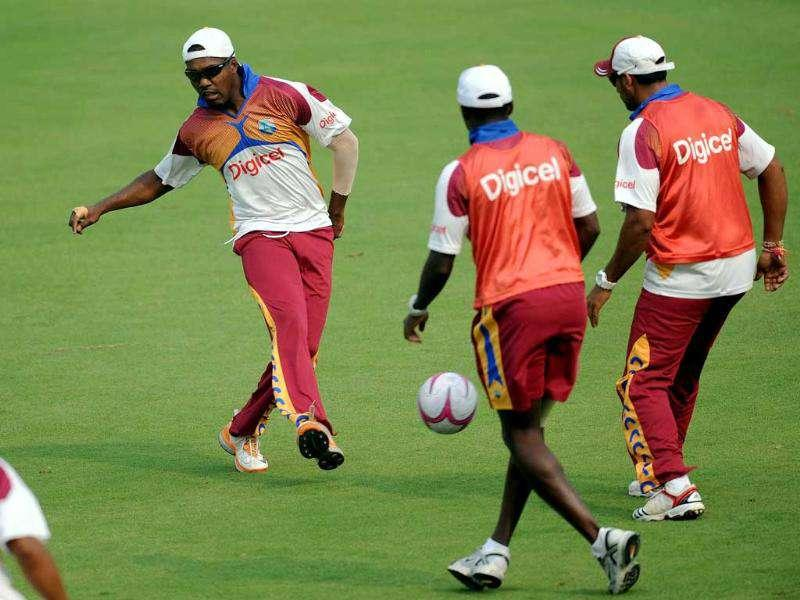 Darren Bravo plays a warm up football match with teammates during a training session at The Ferozeshah Kotla Stadium in New Delhi.