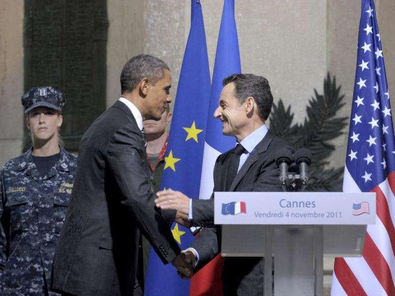 French President Nicholas Sarkozy and US President Barack Obama shake hands during an event at City Hall in Cannes, France.