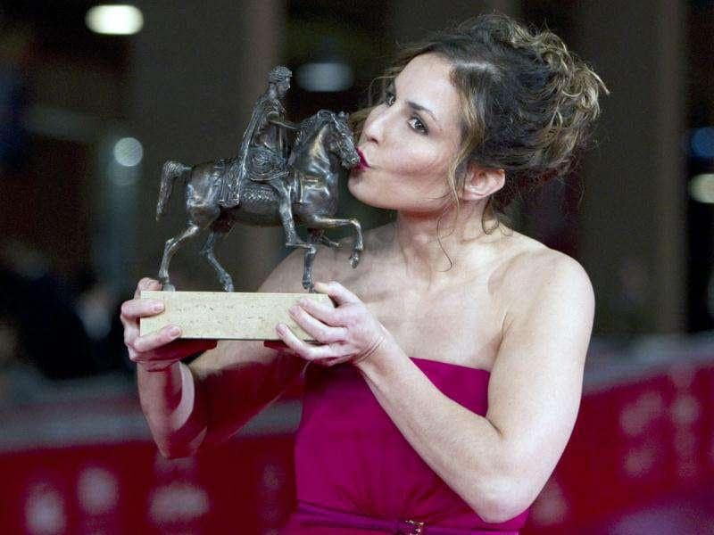 Sweden's actor Noomi Rapace kisses the