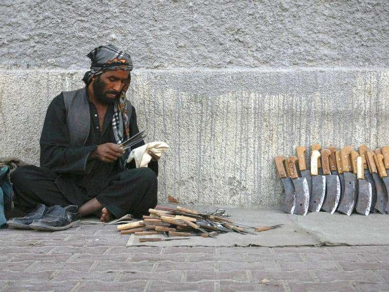 A man cleans knifes and choppers for sale on a sidewalk ahead of the Eid al-Adha festival in Quetta. Muslims around the world celebrate Eid al-Adha, marking the end of the haj, by slaughtering sheep, goats, cows and camels to commemorate Prophet Abraham's willingness to sacrifice his son Ismail on God's command.