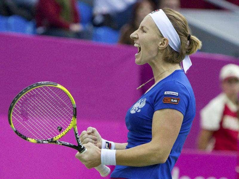 Russia's Svetlana Kuznetsova reacts after winning a point against Czech Republic's Lucie Safarova during their Fed Cup World Group final tennis match in Moscow. (Reuters)