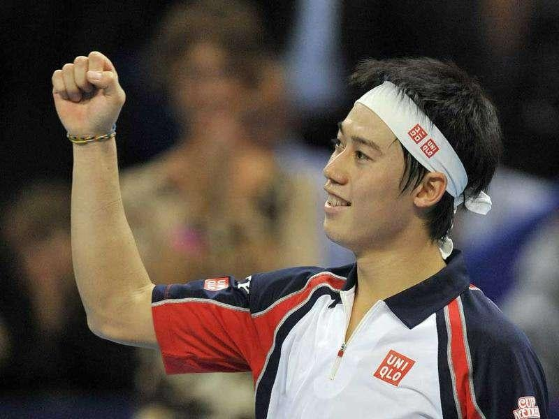 Japan's Kei Nishikori celebrates after winning his semifinal match against Serbia's Novak Djokovic at the Swiss Indoors tennis tournament at the St. Jakobshalle in Basel, Switzerland. (AP)