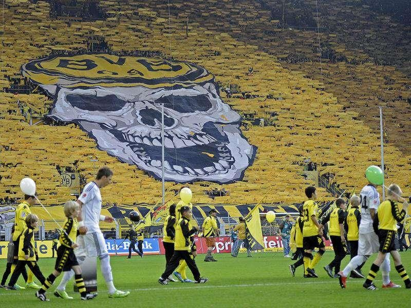 Thousands of Dortmund supporters show a giant skull on the tribune prior the German first division Bundesliga soccer match between Borussia Dortmund an VfL Wolfsburg in Dortmund, Germany.