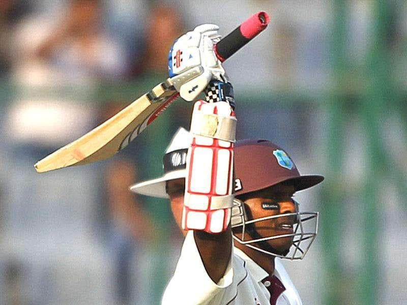 West Indies batsman Shivnarine Chanderpaul celebrates his century during the first day of the first Test match between India and West Indies in New Delhi.