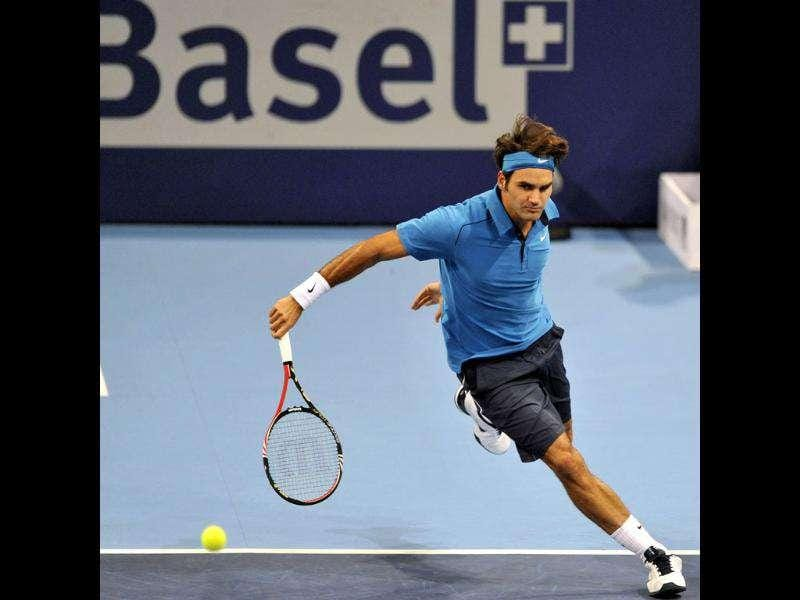 Switzerland's Roger Federer returns a ball to Japan's Kei Nishikori during their final match at the Swiss Indoors tennis tournament at the St. Jakobshalle hall in Basel, Switzerland. (Photo: AP)
