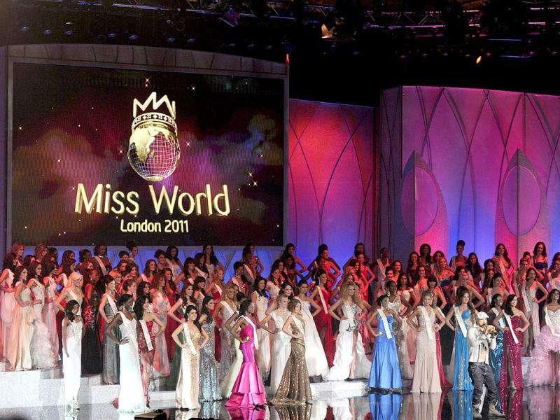 Miss World contestants pose on stage during the finals of Miss World 2011 at Earls Court in London. (Photo: AFP)
