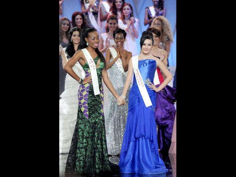 Miss Ghana Stephanie Adwoa Agyeiwaa Karikari (L) and Miss Indonesia Astrid Ellena Indriana Yunadi (R) pose after winning the Beauty with a Purpose round on November 6, 2011 during the finals of Miss World 2011 at Earls Court in London. (Photo: AFP)