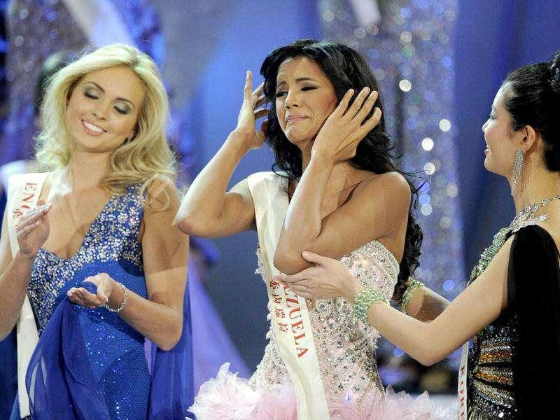 Miss Venezuela Ivian Sarcos (C) reacts as she hears that she has been named Miss World 2011 in Earls Court in west London. (Photo: AFP)