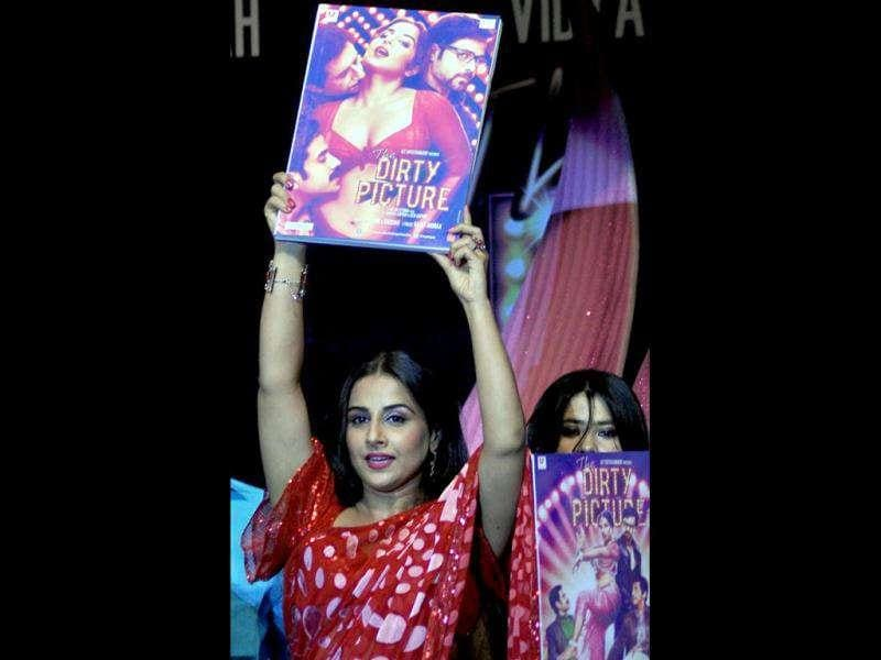 Vidya Balan poses with the film's music CD.