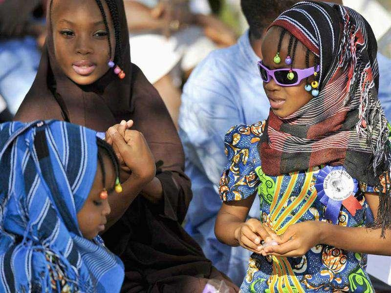 Girls attend prayers marking the Muslim festival of Eid al-Adha in the capital Abuja. Muslims around the world celebrate Eid al-Adha to mark the end of the haj pilgrimage by slaughtering sheep, goats, camels and cows to commemorate Prophet Abraham's willingness to sacrifice his son, Ismail, on God's command.