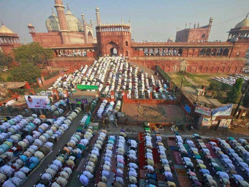 Muslims perform Eid al-Adha prayers at the Jama Masjid (Grand Mosque) in the old quarters of Delhi.