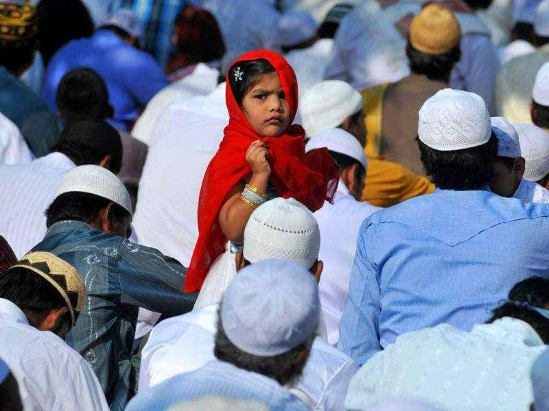 An Indian Muslim girl attends morning prayers of the Eid Al-Adha festival at Ahle Sunnat Al-Jamat Eidgah in Hyderabad.
