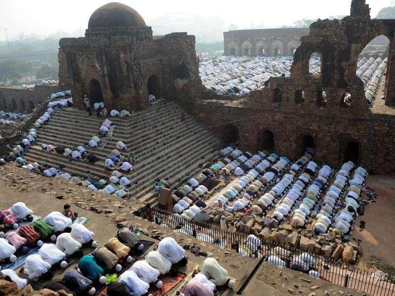 Muslims perform congregational Eid al-Adha morning prayers amongst the ruins of the Feroz Shah Kotla fort and mosque in New Delhi.