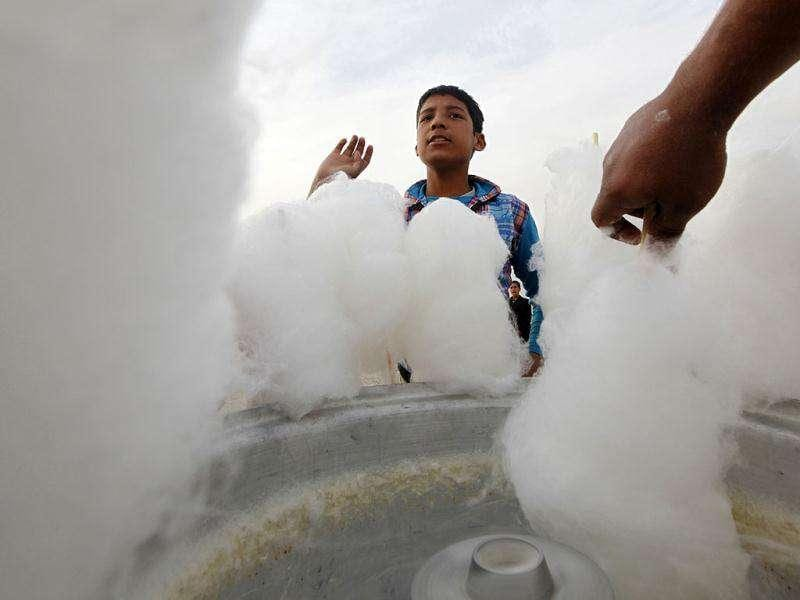 A boy waits for cotton candy on the second day of Eid al-Adha festival in Kabul. Reuters/Umit Bektas