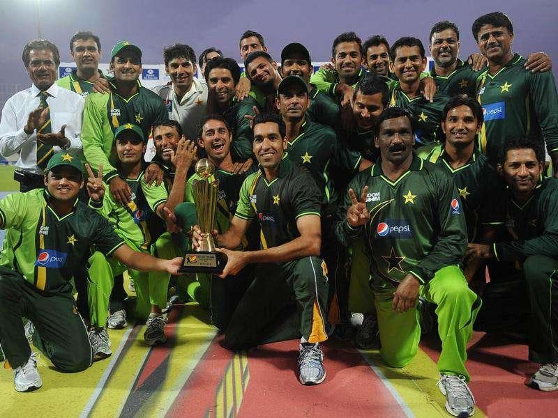 Pakistan's cricketers pose for photographers their after victory three-Test series against Sri Lanka 1-0 at The Sharjah Cricket Stadium in Sharjah.