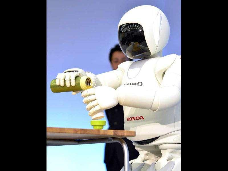 A Honda robot named 'Asimo' performs during a demonstration of its new functions, at the company's laboratory in Wako city, suburban Tokyo.