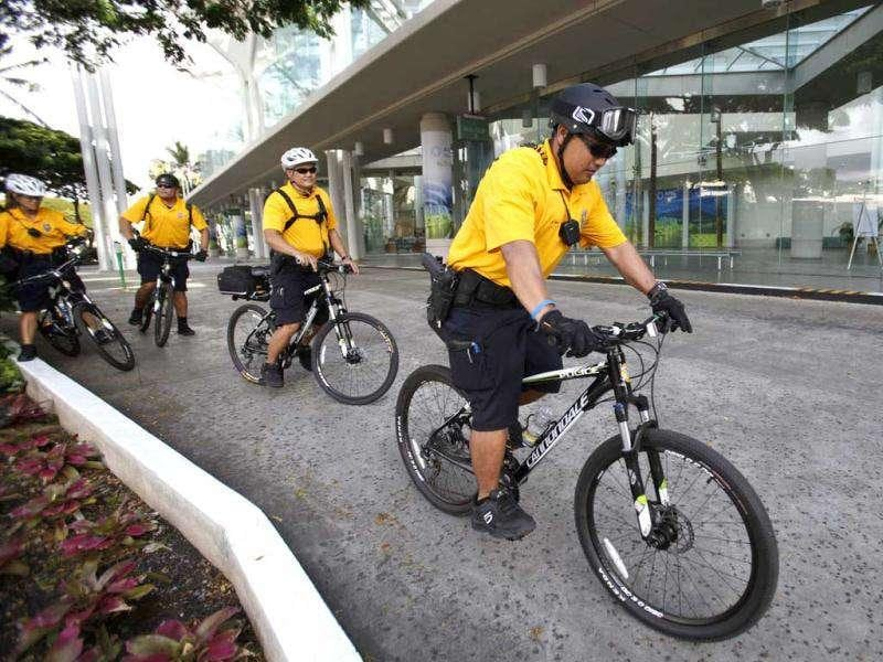 Honolulu police officers patrol the Hawaii Convention Center on bicycles ahead of the Asia-Pacific Economic Cooperation (APEC) summit in Honolulu, Hawaii.