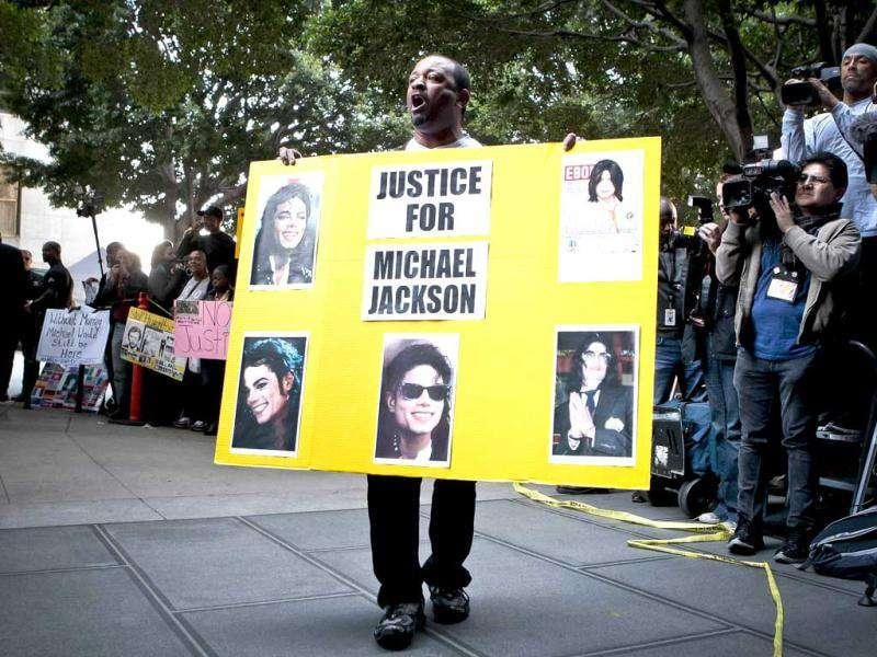 A Michael Jackson fan celebrates in front of the media after it was announced that Dr Conrad Murray, Michael Jackson's physician when the pop star died in 2009, was convicted of involuntary manslaughter at the Criminal Justice Center, in Los Angeles.