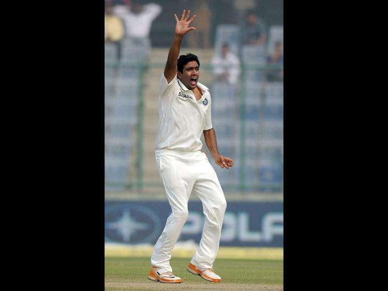 Indian cricketer Ravichandan Ashwin appeals successfully against West Indies cricketer Darren Bravo during the third day of the First Test Match at the Feroz Shah Kotla stadium in New Delhi.