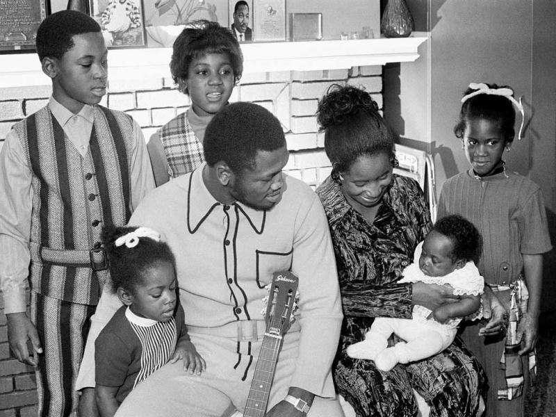 In this file photo, heavyweight champion Joe Frazier and his family pose for a family portrait after he returned from a successful defense of his boxing title in Philadelphia. The former champion died after a brief fight with liver cancer. He was 67. (AP Photo, File)