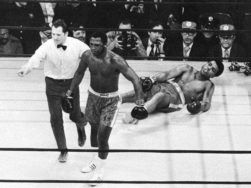 In this file photo, Joe Frazier is directed to a corner by referee Arthur Marcante after Frazier knocked down Muhammad Ali during the 15th round of the title bout in Madison Square Garden in New York. (AP Photo/File)
