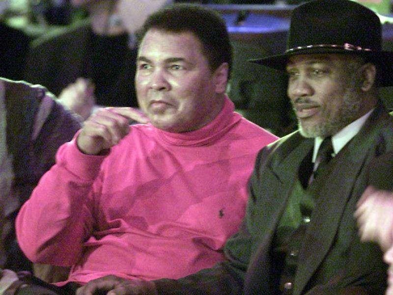 Boxers Muhammad Ali and Joe Frazier (R) talk moments before the 2002 NBA All-Star game at the Philadelphia Convention Center in this February 10, 2002 file photo. (Reuters)