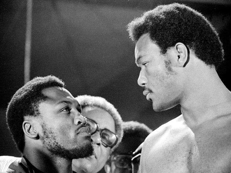 In this file photo, defending WBA champion Joe Frazier, left, and challenger George Foreman have a close look at each other as they meet during the weigh-in moments before their world heavyweight boxing title bout at National Stadium in Kingston, Jamaica. (AP Photo/file)