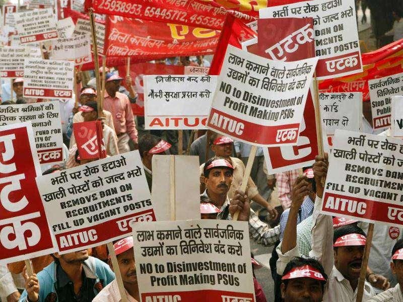 Supporters of All India Trade Union Congress (AITUC) hold placards as they protest against corruption, price-rise and anti-labor policies of the government in New Delhi.
