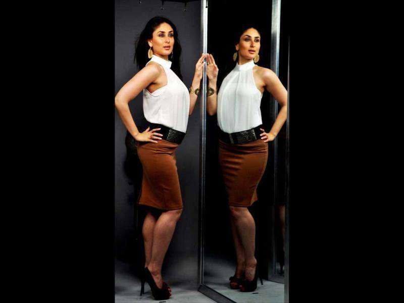 Kareena strikes a pose in a brown short skirt teamed with a white top.