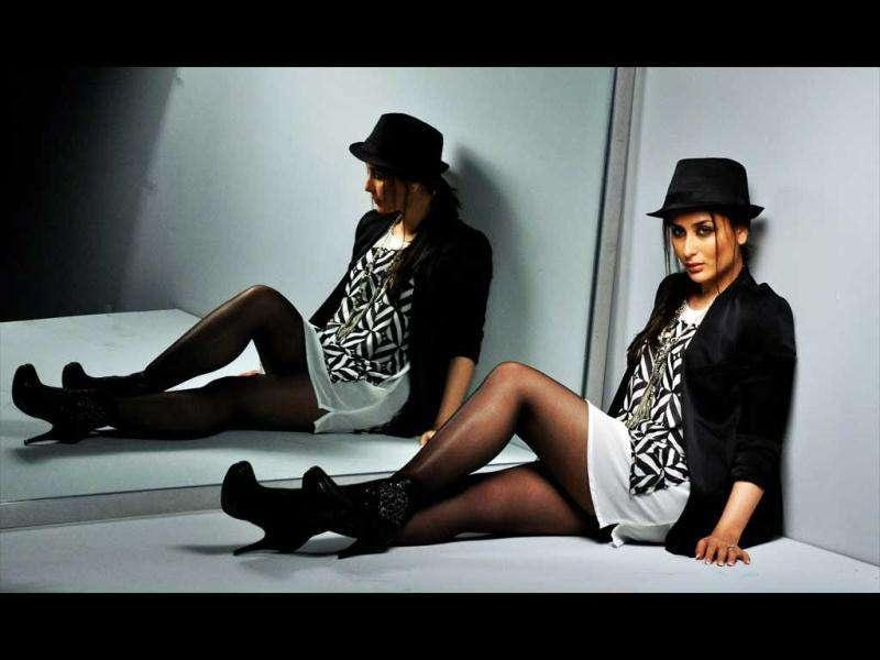 Bebo looks ravishing in a white short dress with a black coat and a hat.