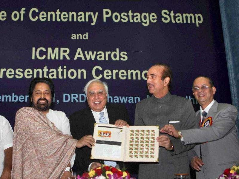 Union minister for human resource development and communications and information technology Kapil Sibal, health minister Ghulam Nabi Azad, ministers of state for health and family welfare S Gandhiselvan (L) and Sudip Bandyopadhyay (2nd L) releasing the commemorative postage stamp on centenary celebrations of Indian Council of Medical Research, in New Delhi.