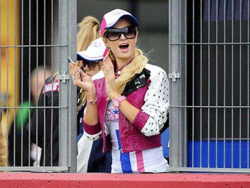 Paris Hilton cheering aloud during the race at Valencia.