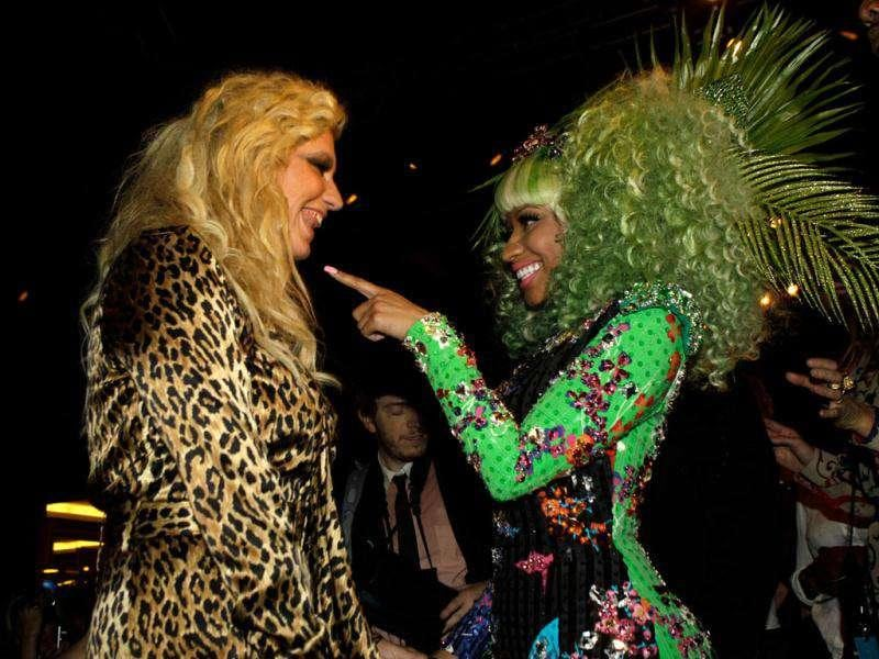 Singer Nicki Minaj, right, and Ke$ha speak during the Versace for H&M launch fashion show in New York.