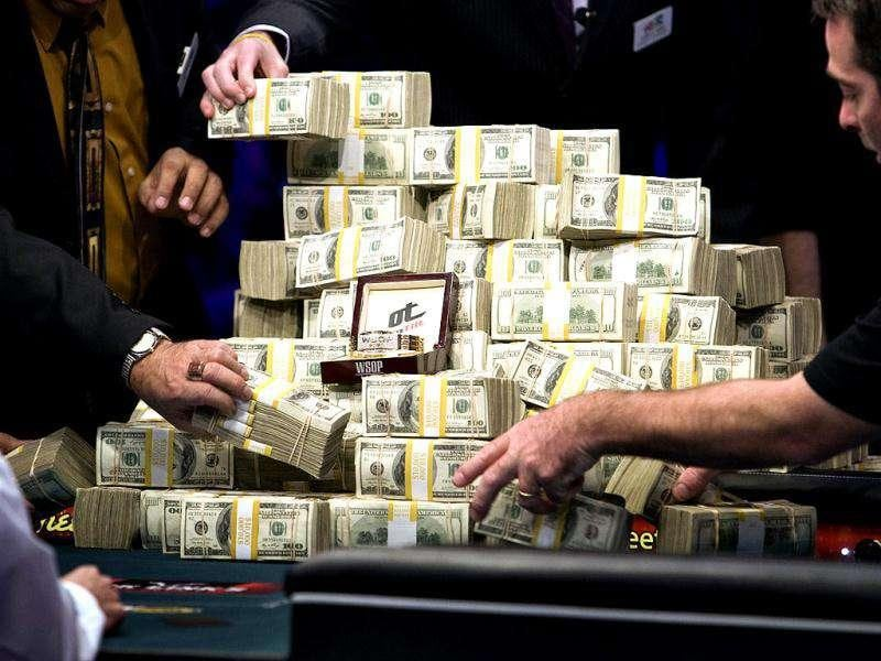Stacks of cash and the World Series of Poker championship bracelet are placed on a table after Germany's Pius Heinz and the Czech Republic's Martin Staszko emerged as finalists during the WSOP main event at the Rio All-Suite Hotel and Casino in Las Vegas. The first place finisher will win $8.7 million and a WSOP championship bracelet.