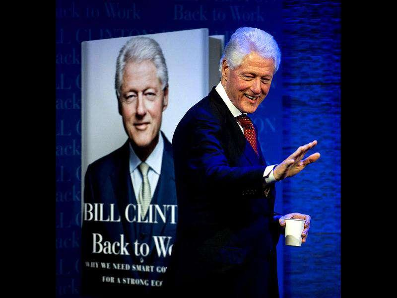 Former US President Bill Clinton waves to the audience upon his arrival at the New York Historical Society in New York. Clinton was interviewed by his daughter Chelsea Clinton about his latest book, Back to Work.
