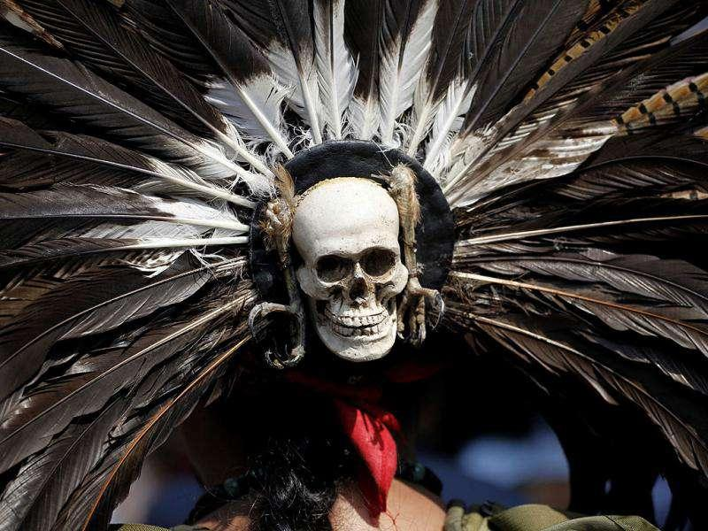 A skull adorns the back of a head piece worn by an Aztec dancer during a demonstration outside Mexico City's Legislative Assembly. The city legislature's Indigenous Commission is proposing a law that would recognize the city's original indigenous population and guarantee their indigenous rights.