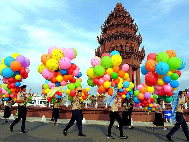 Cambodian scouts carry balloons during a ceremony marking the Independence Day in Phnom Penh. Cambodia was celebrating the 58th anniversary of its independence from France in 1953.