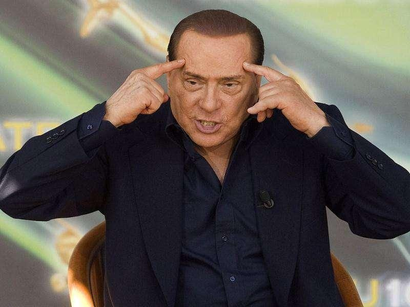 (Files) Silvio Berlusconi gestures during the Atreju10 political meeting in Rome in this September 12, 2010 file photograph. REUTERS/Remo Casilli