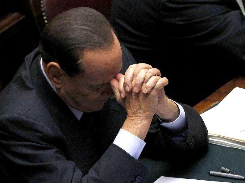 Silvio Berlusconi attends a debate at the lower house of parliament in Rome in this September 22, 2011 file photograph. REUTERS/Alessandro Bianchi