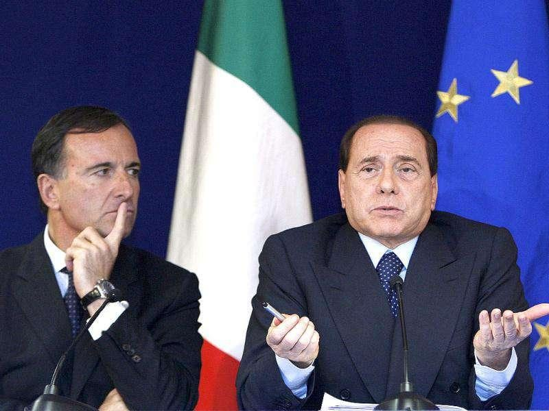 Foreign minister Franco Frattini (L) and Prime Minister Silvio Berlusconi hold a news conference at the end of a European Union leaders summit in Brussels in this October 16, 2008 file photograph. REUTERS/Yves Herman