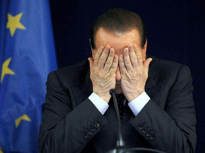 Silvio Berlusconi addresses a news conference at the end of an EU summit in Brussels in this June 20, 2008 file photograph. REUTERS/Marco Valdo