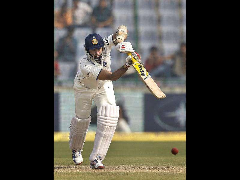 VVS Laxman plays a shot on the fourth day of the first of the three cricket test match series between India and West Indies, in New Delhi.