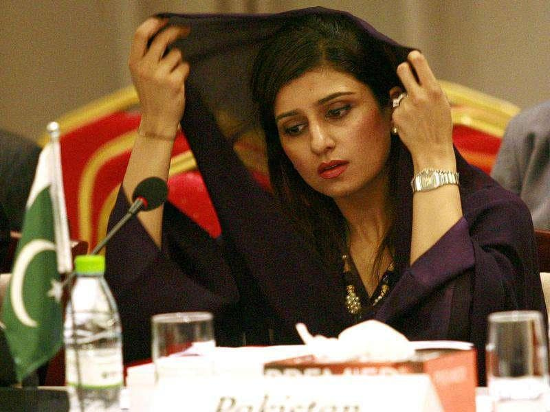 Pakistan's Foreign Minister Hina Rabbani Khar adjusts her scarf during the Saarc countries foreign ministers meeting in Addu.