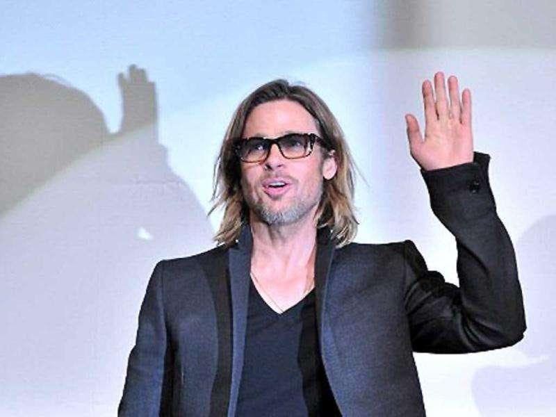 Brad Pitt waves to his fans.