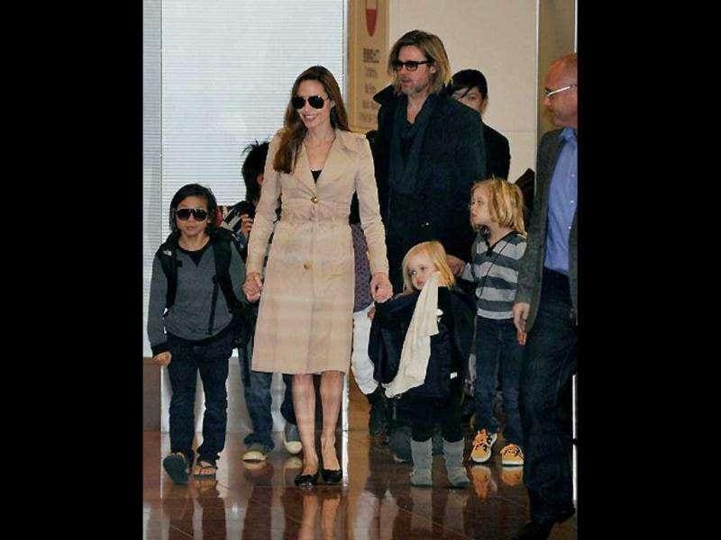 Brad and Angelina pose with their family for the paparazzi.