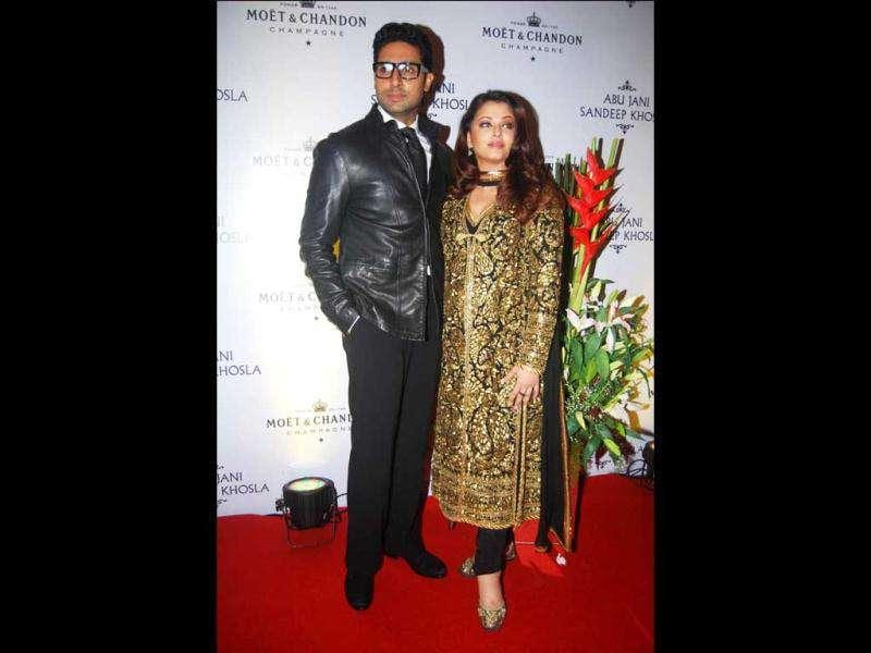 Abhishek can be seen in a black jacket over black pants.