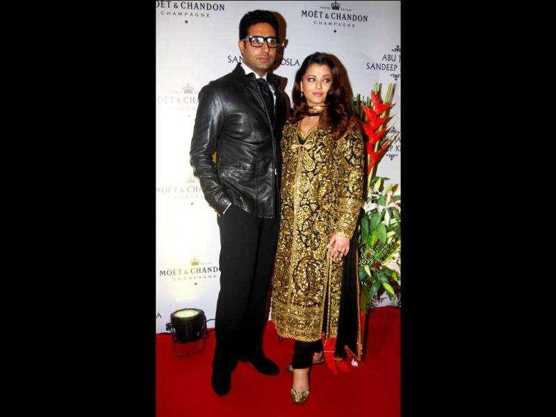 Aishwarya is clad in a heavily embroidered golden-black suit.